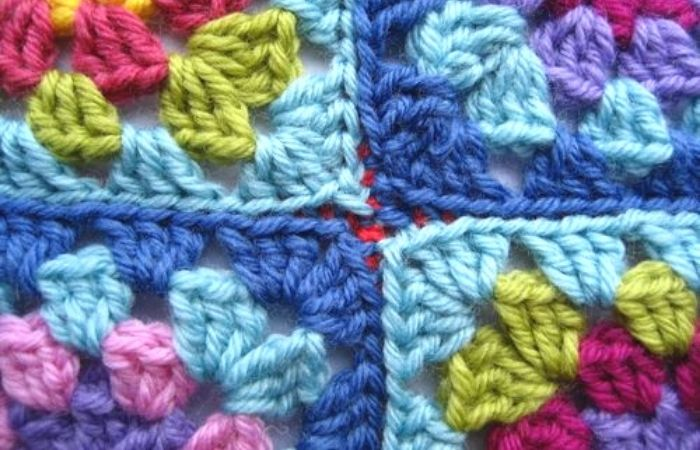 Ways to join granny squares, slip stitch on the back.